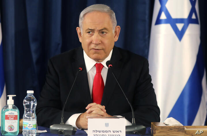Israeli Prime Minister Benjamin Netanyahu chairs the weekly cabinet meeting in Jerusalem, Sunday, June 7, 2020. (Menahem Kahana…