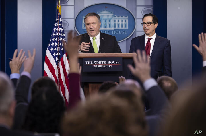 Secretary of State Mike Pompeo and Treasury Secretary Steve Mnuchin brief reporters about additional sanctions placed on Iran,…
