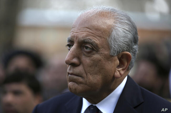 FILE - In this March 9, 2020, file photo, Washington's peace envoy Zalmay Khalilzad attends the inauguration ceremony for…