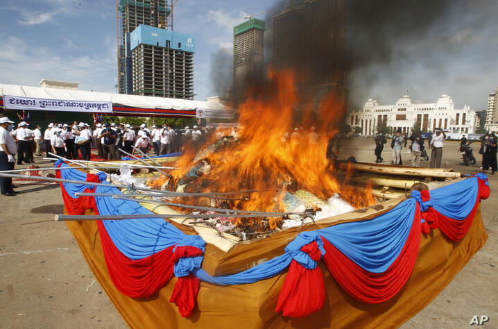 A pile of drugs burns during an event to mark the International Day Against Drug Abuse and Illicit Trafficking, in Phnom Penh,…