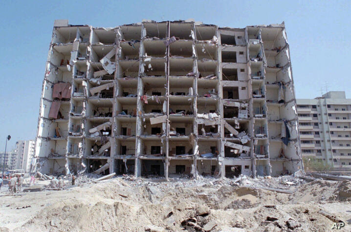 FILE - This June 30,1996 file photo, show a general view of the destroyed Khobar Towers and crater where a truck bomb exploded…