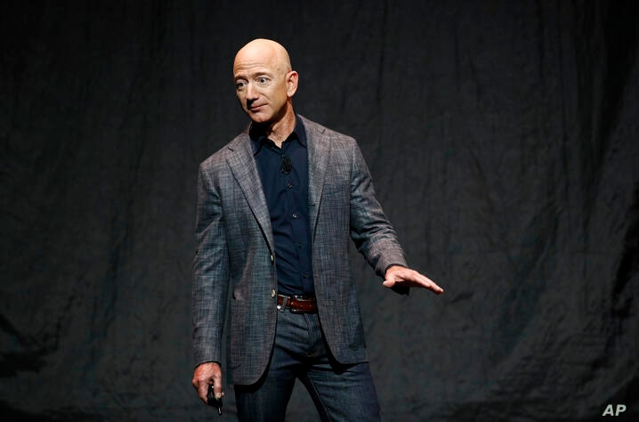 Jeff Bezos speaks at an event before unveiling Blue Origin's Blue Moon lunar lander, Thursday, May 9, 2019, in Washington. (AP…