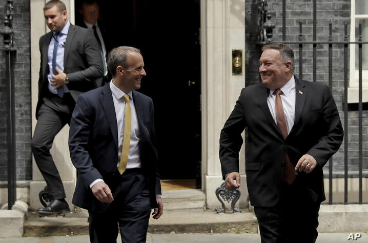 U.S. Secretary of State Mike Pompeo, right, walks with British Foreign Secretary Dominic Raab, from 10 Downing Street to go to…