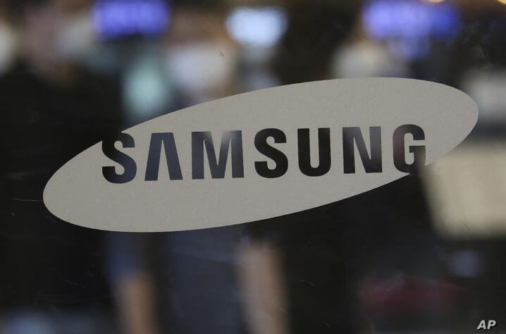 The logo of the Samsung Electronics Co. is seen at its shop in Seoul, South Korea, Tuesday, July 7, 2020. Samsung Electronics…