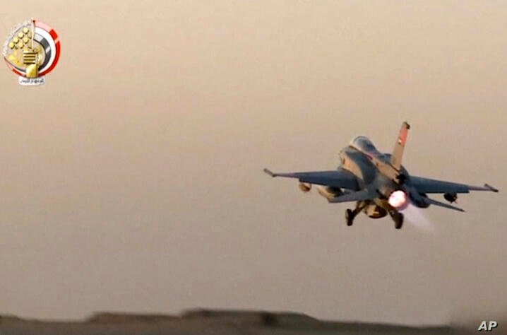In this still image taken from video provided by the Egyptian military, an Egyptian fighter jet takes off from an undisclosed…