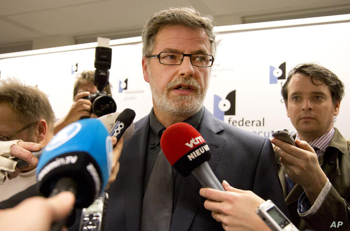 Eric Van Der Sypt, center, from the Brussels federal prosecutors office speaks with the media at police headquarters in…