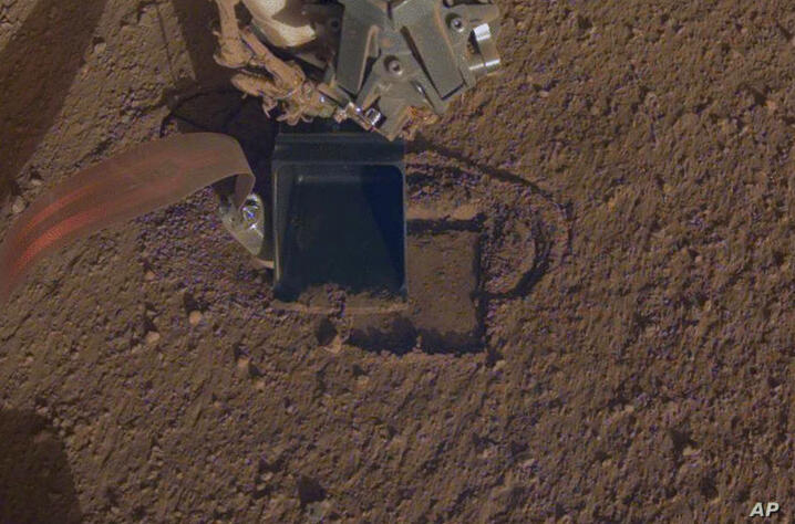 This October 2019 photo made available by NASA shows InSight's heat probe digging into the surface of Mars. On Thursday, Oct…