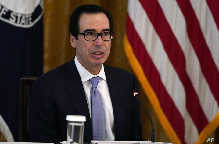 Treasury Secretary Steven Mnuchin speaks during a Cabinet Meeting in the East Room of the White House, Tuesday, May 19, 2020,…