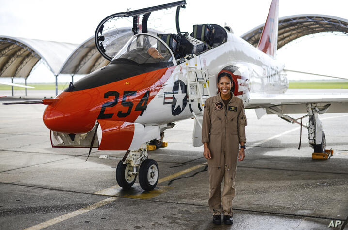 In this photo provided by the U.S. Navy, student Naval aviator Lt. j.g. Madeline Swegle, assigned to the Redhawks of Training…