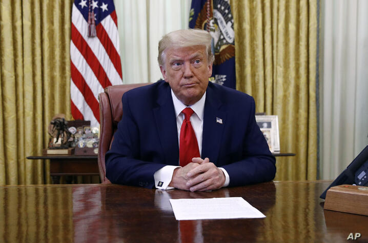 President Donald Trump participates in a law enforcement briefing on the MS-13 gang in the Oval Office of the White House,…
