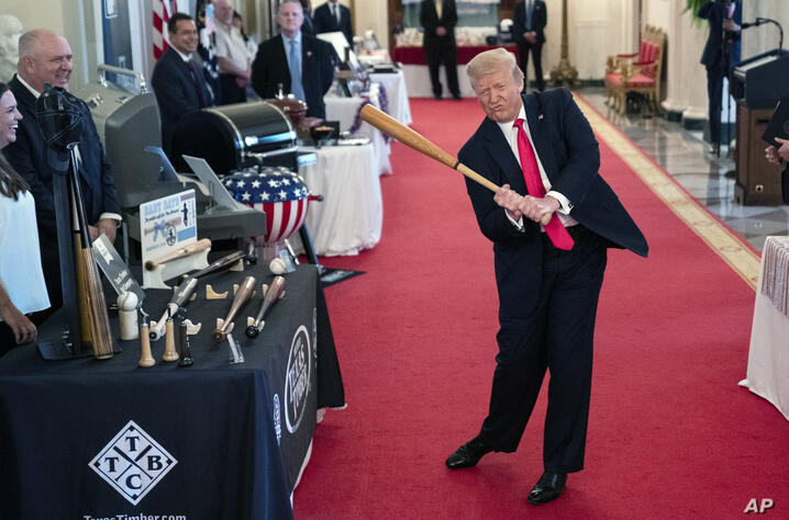 President Donald Trump swings a baseball bat during the Spirit of America Showcase at the White House, Thursday, July 2, 2020,…