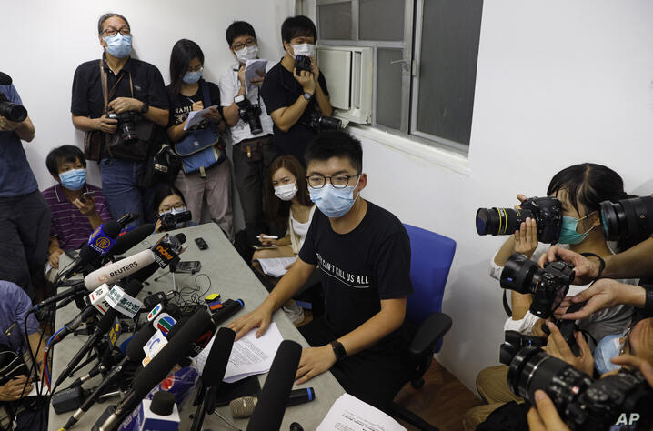 Hong Kong pro-democracy activist Joshua Wong, center, attends a press conference in Hong Kong, Friday, July 31, 2020. On…
