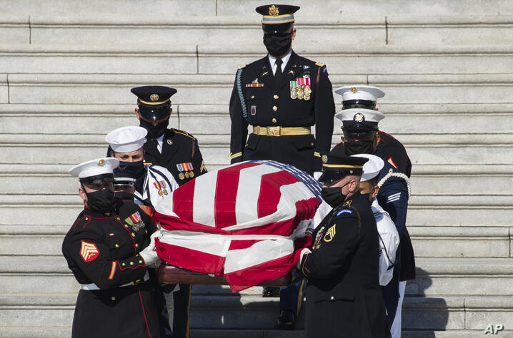 The flag-draped casket of the late Rep. John Lewis, D-Ga., is carried by a joint services military honor guard down the East…