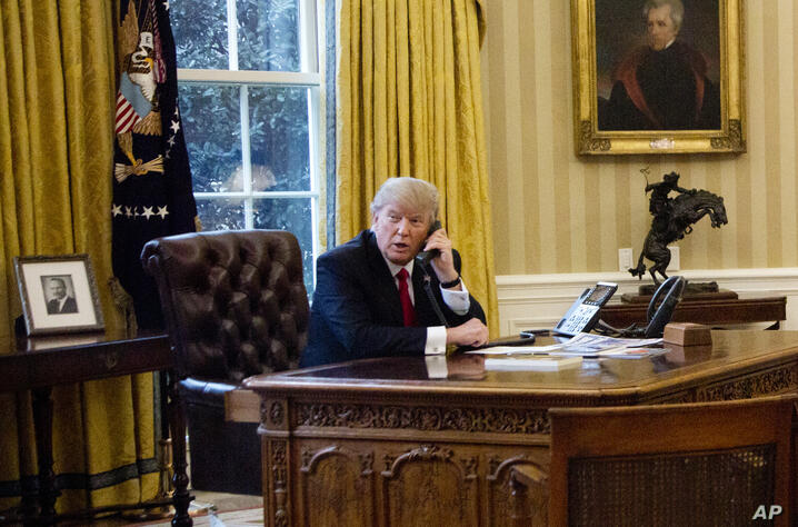 President Donald Trump speaks on the phone with King of Saudi Arabia Salman bin Abd al-Aziz Al Saud in the Oval Office at the…