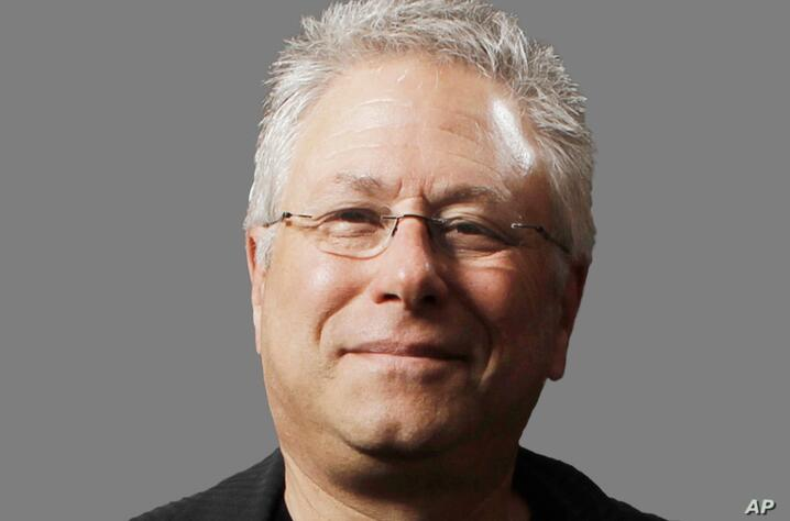 Alan Menken headshot, composer, graphic element on gray