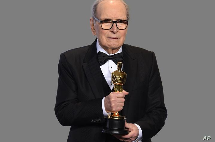 Ennio Morricone, Italian composer, poses with the award for best original score for The Hateful Eight, at the Oscars, Dolby…
