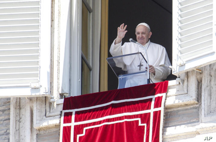 Pope Francis waves to faithful from his studio window overlooking St. Peter's Square at the Vatican, as he leaves at the end of…