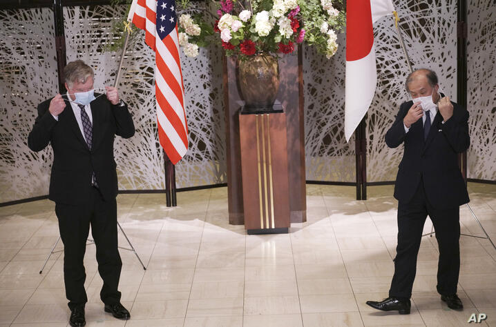 U.S. Special Representative for North Korea Stephen Biegun, left, and Japanese Vice Foreign Minister Takeo Akiba, right, take…