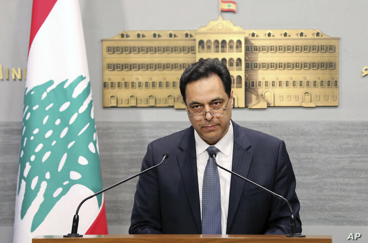 In this photo released by the Lebanese Government, Lebanese Prime Minister Hassan Diab, gives a speech at the Government House…