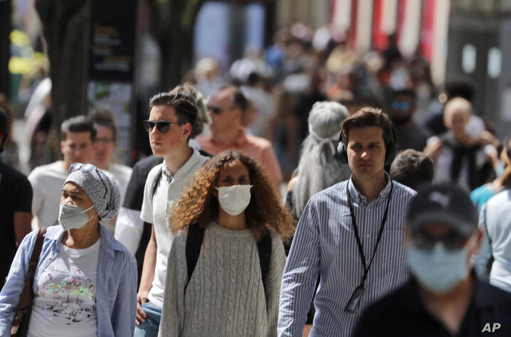 Shoppers wear face masks to protect themselves from COVID-19 as they walk along Oxford Street in London, Friday, July 24, 2020…