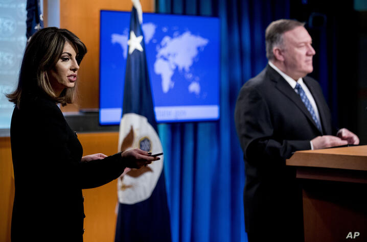 State Department spokeswoman Morgan Ortagus, left, calls on a reporter during a news conference with Secretary of State Mike…