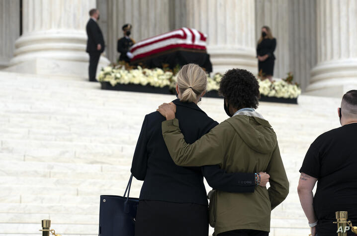 A couple pays their respects as Justice Ruth Bader Ginsburg lies in repose under the Portico at the top of the front steps of…
