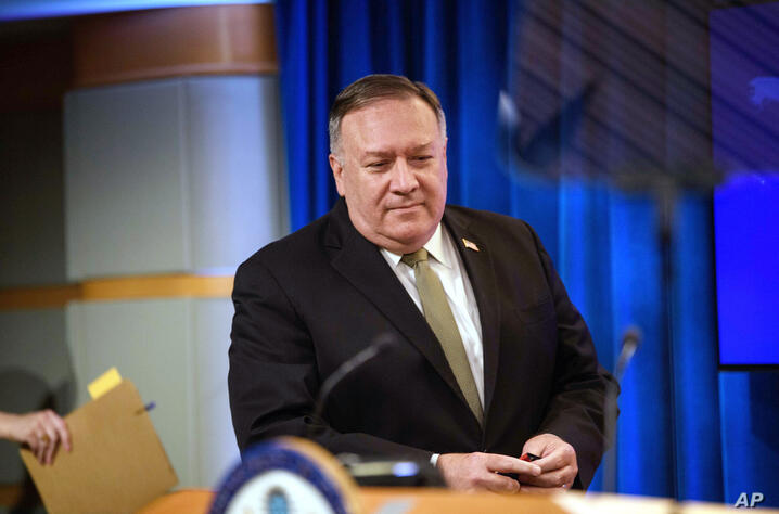 Secretary of State Mike Pompeo arrives to speak at a news conference at the State Department in Washington, Wednesday, Sept. 2,…