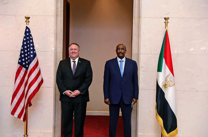 FILE - In this Aug. 25, 2020 file photo, U.S. Secretary of State Mike Pompeo stands with Sudanese Gen. Abdel-Fattah Burhan, the…