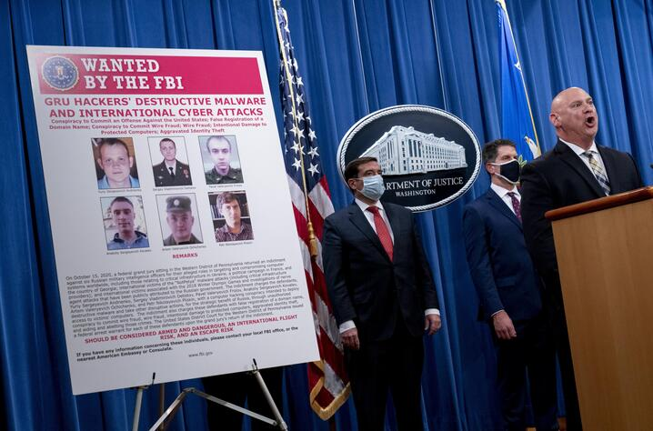 A poster showing six wanted Russian military intelligence officers is displayed as FBI Special Agent in Charge of the…