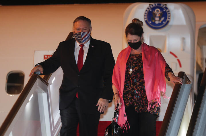 U.S. Secretary of State Mike Pompeo, and his wife Susan disembark from an aircraft upon their arrival at the airport in Colombo…