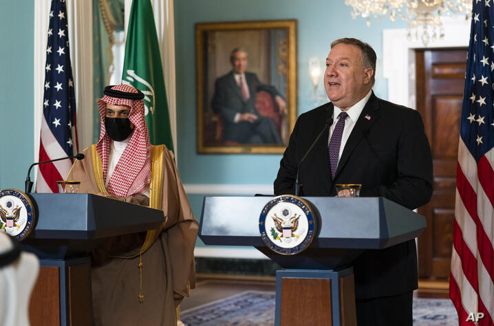 Saudi Minister of Foreign Affairs Prince Faisal bin Farhan Al Saud listens to Secretary of State Mike Pompeo, right, speaks…