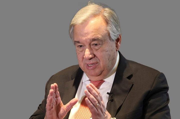 Antonio Guterres, as UN Secretary General, graphic element on gray