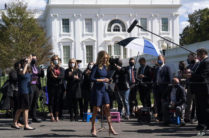 White House press secretary Kayleigh McEnany departs after speaking with reporters at the White House, Friday, Oct. 2, 2020, in…