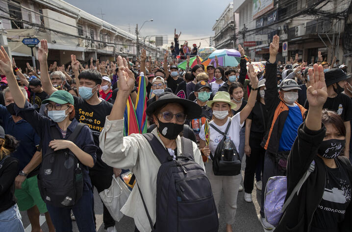 Pro-democracy protesters flash three-fingered salute during a street march in Bangkok, Thailand, Wednesday, Oct. 14, 2020…