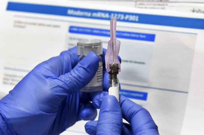 FILE - In this Monday, July 27, 2020 file photo, a nurse prepares a shot as a study of a possible COVID-19 vaccine, developed…