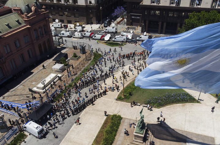 People line up outside the presidential palace alongside Plaza de Mayo, to pay final respects to Diego Maradona, in Buenos…