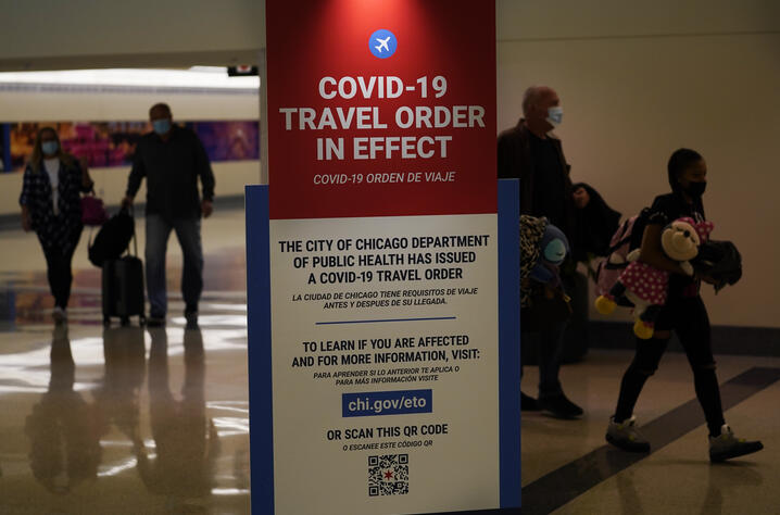 Air travelers arriving Tuesday, Nov. 24, 2020, at Midway Airport in Chicago are reminded of the city's COVID-19 travel orders…