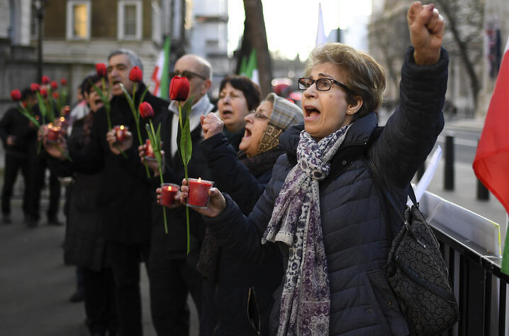 People take part in a vigil held by The Anglo-Iranian Communities in the UK and supporters of the National Council of…