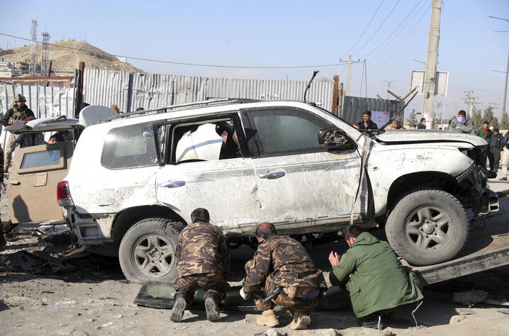 Afghan security personnel inspect the site of a bomb attack in Kabul, Afghanistan, Tuesday, Dec. 15, 2020. A bombing and a…