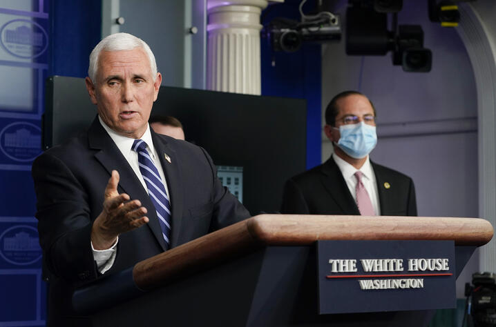 Health and Human Services Secretary Alex Azar, right, listens as Vice President Mike Pence speaks during a news conference with…