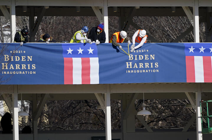 Workers put up bunting on a press riser for the upcoming inauguration of President-Elect Biden and Vice President-Elect Kamala…