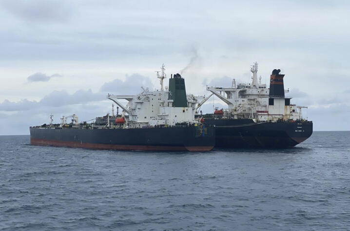 In this photo released by Indonesian Maritime Security Agency (BAKAMLA), Iranian-flagged MT Horse, left, and Panamanian-flagged…