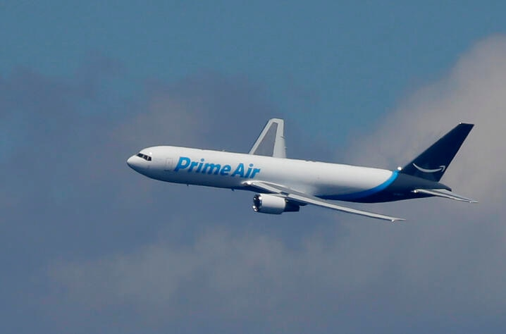 """A Boeing 767 with an Amazon.com """"Prime Air"""" livery flies over Lake Washington, Friday, Aug. 5, 2016, as part of the Boeing…"""