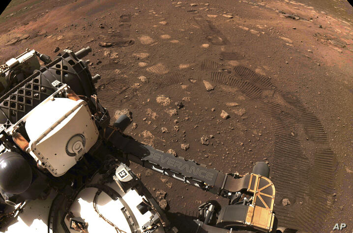 This photo made available by NASA was taken during the first drive of the Perseverance rover on Mars on Thursday, March 4, 2021…