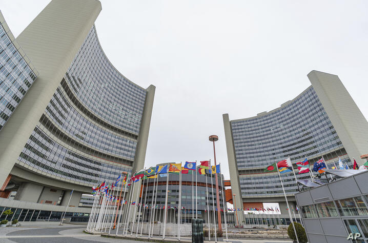 FILE - In this Monday, May 24, 2021 file photo, the flag of UN states wave in front of the the International Center building…