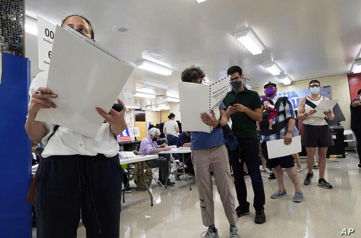 Voters wait to mark their ballots at Frank McCourt High School, in New York, Tuesday, June 22, 2021. The final votes are set to…
