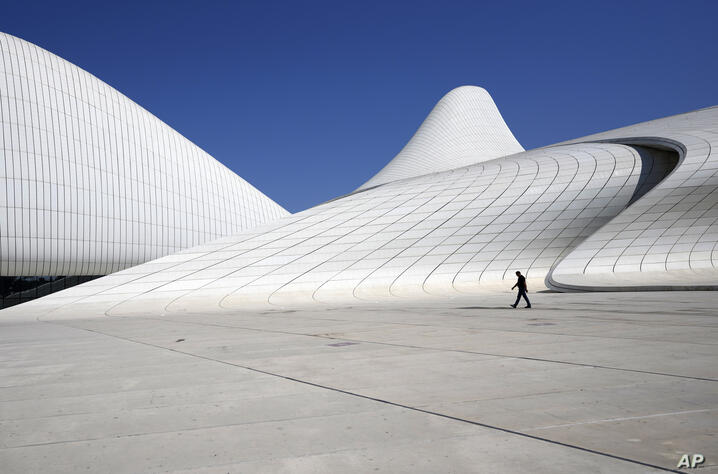 A man walks in front of the Heydar Aliyev Cultural Centre before the upcoming Euro 2020 soccer championship in Baku, Azerbaijan…