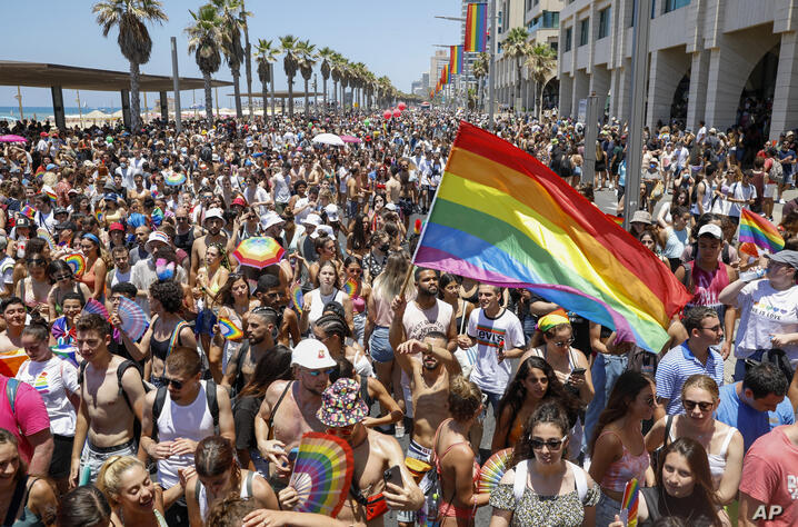 People participate in the annual Pride Parade, in Tel Aviv, Israel, Friday, June 25, 2021. Tens of thousands of people attended…