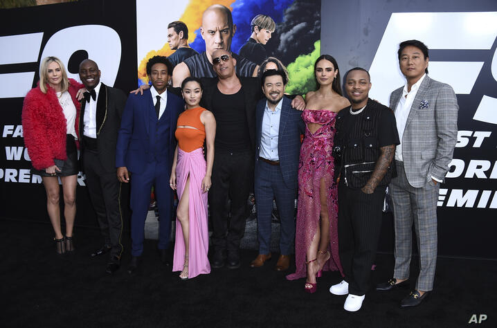 Charlize Theron, from left, Tyrese Gibson, Ludacris, Anna Sawai, Vin Diesel, Justin Lin, Jordana Brewster, Shad Moss, and Sung…