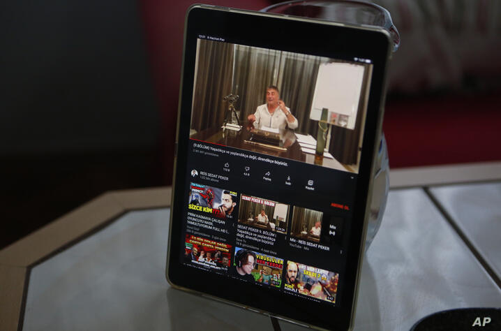 A tablet on the breakfast table of Alparslan Atas and his wife Gulistan at their home in Istanbul, shows the latest video of…